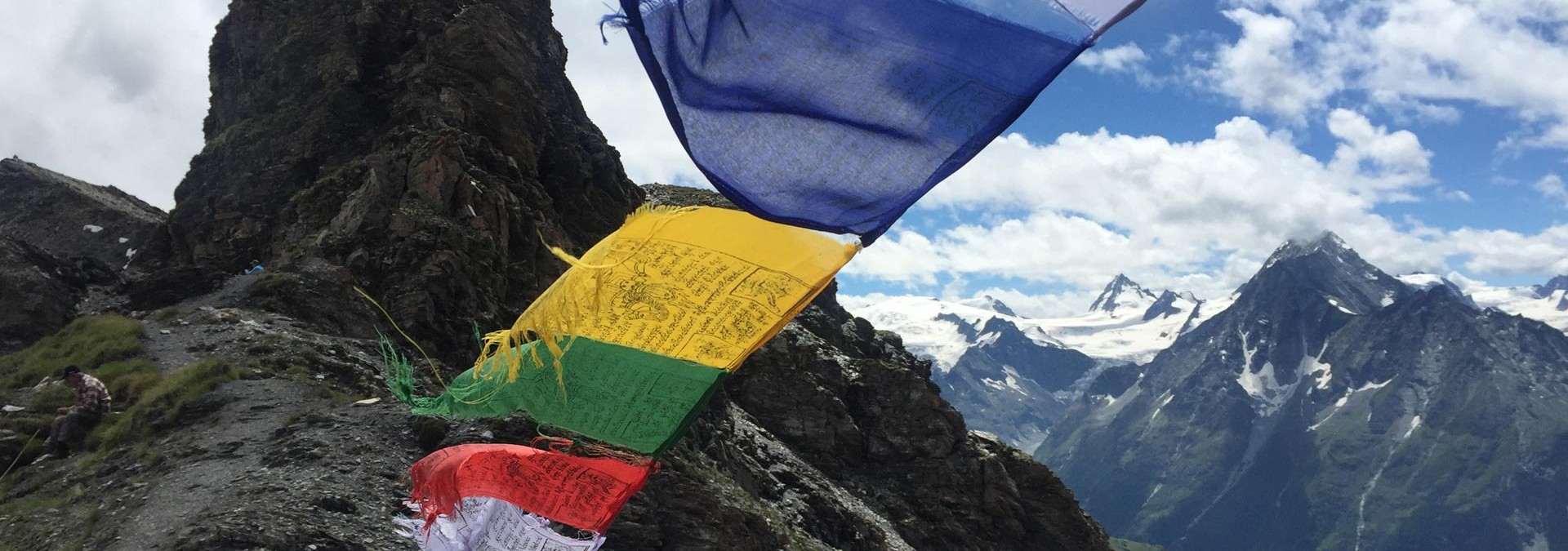 Classic Haute Route - Tibetan prayer flags blowing with the wind on the col de Torrent