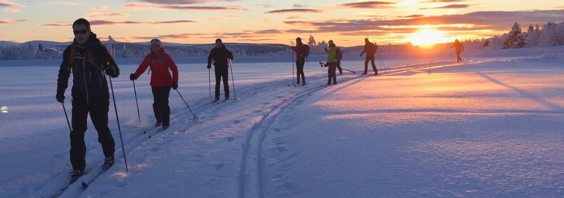 Putting our new found skills into practice on a ski journey in the sunset. Glorious!